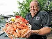 MOUTH-WATERING: Des Stewart, from The Bridge Seafoods at Mooloolaba, with a seafood platter ahead of the busy Christmas period.