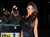 "KATIE Price has blasted her ex-husband Peter Andre as a ""fake family man""."