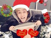 MILEY Cyrus flashed her breasts for a Christmas card.
