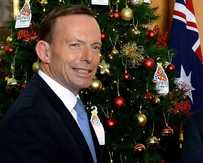 MOOD SWING: Tony Abbott needs to swap blue for yellow ties.