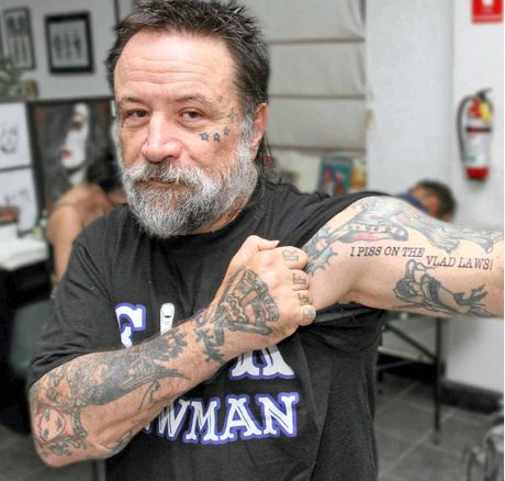 SAYING IT IN INK: Angelo Garozzo has joined a Rebels bikie's call for police to put up or shut up.