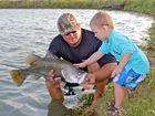 Three-year-old reels in barramundi