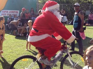Santa Claus arrives at the Goonellabah Community Christmas Party.