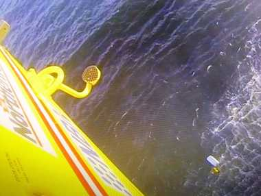 An image from the Westpac Life Saver Rescue Helicopter showing the rescue of two men who spent the night in the water after their boat overturned.