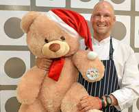 CHEERING UP FINN: Celebrity chef Matt Golinski appeared at Maroochydore's Harvey Norman for a cooking demonstration. He organised this giant teddy bear for Finn Smith.