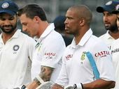SOUTH African batsmen Vernon Philander and Dale Steyn were booed off the Wanderers after they settled for a draw, rather than go for a historic record win.