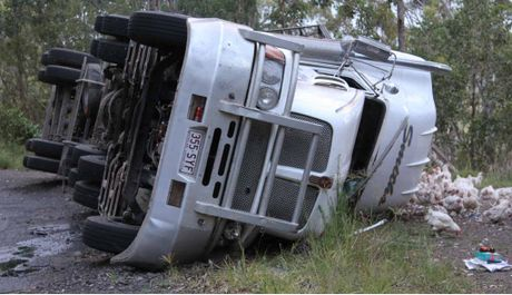 YET ANOTHER: This semi carrying chickens to Toowoomba toppled on the Mt Lindesay Rd near Legume.