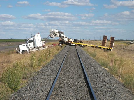 The truck stranded on railway lines after it left the Warrego Hwy.