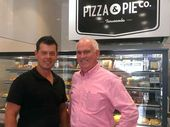 Toowoomba Chamber of Commerce and Industry CEO Greg Johnson welcomes Rob Balderson of Pizza & Pie Co to the chamber.