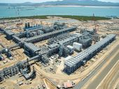 BG Group's QCLNG project is on track to start commissioning its Curtis Island plant in the first quarter of 2014, according to its full year results statement.