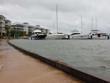 Residents flocked to Cannonvale foreshore on foot after police closed the road on Friday morning.