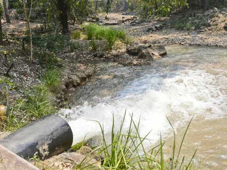 DRAINING AWAY: A pipe pumps water into the downstream section of Goolang Creek.