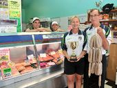 SNAG SUCCESS: (From left) Luke Went, Cameron Salmon, (at front) Felicity Hanna, and Garry Leeson, of Ocean Shores Quality Meats. Garry has won the poultry section in the national finals of the Sausage King competition for his chicken, spinach and macadamia nut sausages.