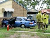A YOUNG woman has escaped serious injury after a car ploughed into the front of her house.