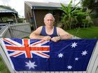 A GOODNA Vietnam veteran will be able to fly the Australian flag in his front yard after Minister for Housing Tim Mander rang to give him a personal guarantee.