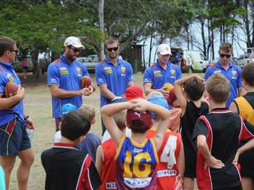 Local Aussie Rules youngsters got to rub shoulders with the big boys at the Brisbane Lions Auskick clinic at Seafront Oval.