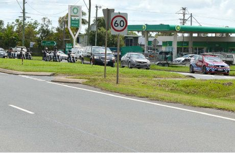 "A funeral cortege of motorbike riders passes police on Harbour Rd, heading to the chapel for Rebels member Gregory ""Dodgie"" Delbridge's funeral."