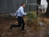 THE irony of a drought tour being hampered by heavy rainfall wasn't lost on Tony Abbott.