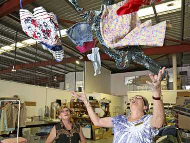 HEAPS OF CLOTHES: Joann Jeffery and Jan Allum throw up some of the items that will be available in the Lifeline $2 Clothing Sale. See some of the items below left.