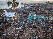 IN less than a second Chris McGrath captured an image that showed the world the devastation caused by Typhoon Haiyan when it ripped through the Philippines.