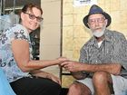 THE Byron Bay community has rallied around popular palm reader, Peter Wilton after Byron Shire Council threatened to revoke his busker's licence.