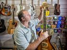 UNFINISHED guitar bodies and spare fretboards are scattered around Paul Kneller's Maclean home workshop.