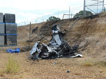 Police at the scene of a plane crashed at Gatton early Sunday morning.