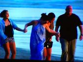 Schapelle Corby goes for a swim at Seminyak Beach in a scene from Sunday Night.