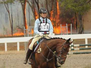 Horseriders moved their mounts away from fires at the Maryborough showgrounds on Saturday.