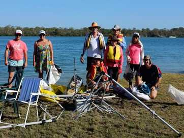 A group of volunteers on kayaks, assisted by a mother ship, managed to remove rubbish from the banks of the Elliott River on Clean Up Australia Day.