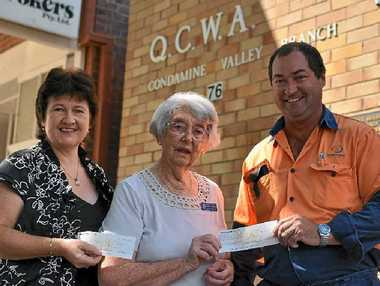 HELPING HAND: QCWA's Judy Bilbrough (centre) hands over tertiary student bursaries to local parents Tricia Kelly and Vance Sinden.