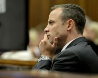Oscar Pistorius listens to the evidence at his murder trial.