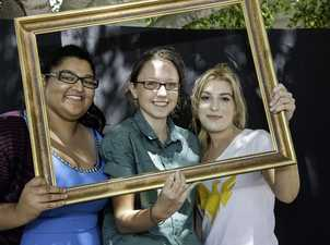 Framed and ready for fun at the USQ Fraser Coast Phoenix Carnival are former Urangan State High School students Jasmin Rai (left) and Hannah McRoberts with USQ student ambassador Ashleigh Emblem.