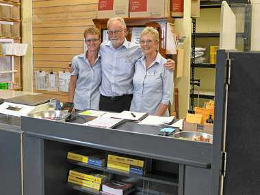 BACK IN ACTION: The Montville Post Office has reopened in the Montville IGA Xpress. Chris and Ann Wells and their daughter Sara (left) have taken on the licence.