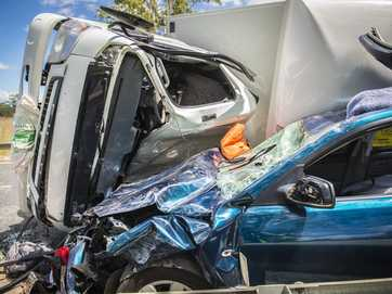 A truck rolled and hit a car on the Bruce Highway between Ambrose and Raglan on Thursday.