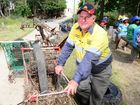 COUNCILLOR Neil Fisher felt litter-ally down in the dumps when he came across shopping trolleys strewn all the way along Moores Creek.