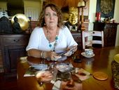 Karen Boyd with photos of her sons injuries. Photo Allan Reinikka / The Morning Bulletin