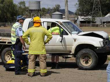 Emergency services at the scene of a two-vehicle crash on the Warrego Hwy.