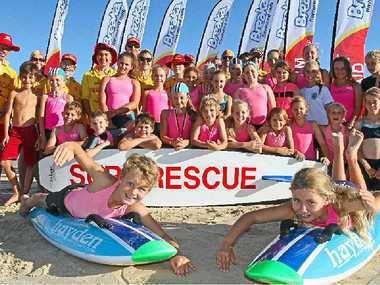 FOR THE KIDS: Mudjimba Surf Lifesaving Club is happy to receive new flags courtesy of Breaka.