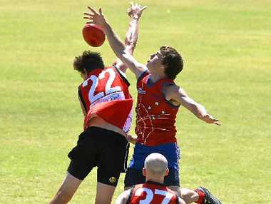 POSSESSION BATTLE: Redback Brent Walker (right) goes for the ball in a game at Reddies Oval.