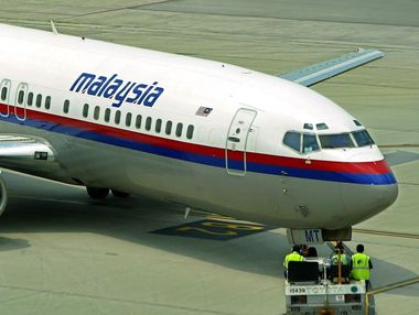 A Malaysia airlines plane is being pulled at the Kuala Lumpur International Airport in Sepang.