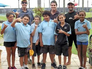 RIGHT: Indigenous Swim & Surf's Steve Watts (left), Eli Cook, and Ben Dickens with their indigenous class.