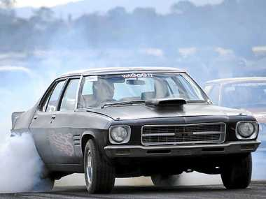 MOTORING AHEAD: A Holden GTS burns rubber at a Summerland Drags meet in Casino.