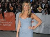 JENNIFER Aniston is thinking about becoming a Buddhist.
