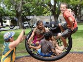 IN THE SWING: Children try out the new play equipment at See Park, Grafton. Photo Debrah Novak / The Daily Examiner