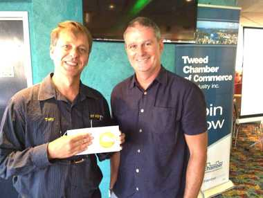 NR Signs owner Tony Worrad, with Scoot Australia GM Darren Wright, won a trip to Singapore.