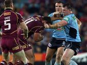 BOILING OVER: Paul Gallen and Nate Myles let fly during the opening match of the 2013 State of Origin rugby league series.