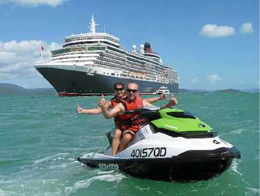 ROYAL VISIT: Townsville newlyweds Kris and Vicky Brennan enjoyed a close shave with visiting cruise ship the Queen Elizabeth on their Whitsunday Jetski Tours 'Daydream extreme' tour.