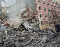 Emergency workers respond to the scene of an explosion that leveled two apartment buildings in the East Harlem neighborhood of New York.