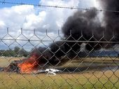 AN allegedly unsecured pilot's seat is being investigated as the cause of a plane crash that killed four skydivers and a pilot at Caboolture Airfield.